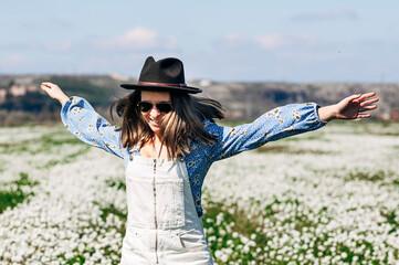 Happy running woman in flower field