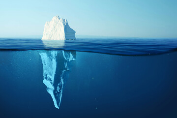 Iceberg in clear blue water and hidden danger under water. Iceberg - Hidden Danger And Global Warming Concept. Floating ice in ocean. Copyspace for text and design