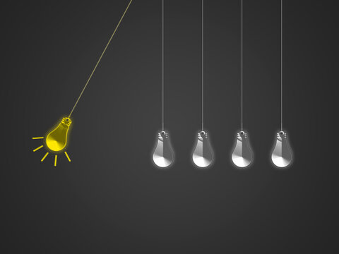Newton cradle with Metal light bulb in grey background.  hanging 3d white bulbs with one yellow moving bulb light. Creativity and science Concept.