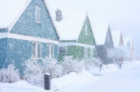 Houses in extremely cold, snowy and frosty winter storm conditions.
