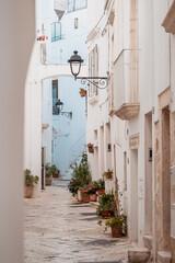 narrow alley in the picturesque oldtown of Locorotondo, Puglia