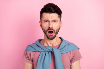 Photo of unhappy shocked angry young man bad mood news negative isolated on pastel pink color background