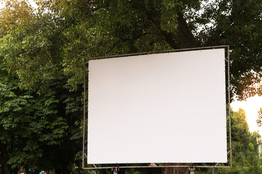 Open air cinema or theater, outdoors movie. Large empty movie screen with copy space