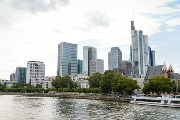 Beautiful view of modern skyscrapers at the financial district alongside river Main, skyline in downtown, cityscape with blue sky, clouds, sunny summer day, Frankfurt am Main, Germany Wall mural