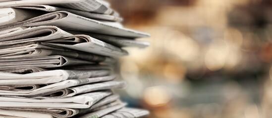 Fototapeta Pile of newspapers stacks on blur background obraz