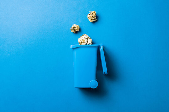 Recycling sorting. Bin container for disposal garbage waste and save environment. Blue dustbin for recycle paper trash isolated on blue background.