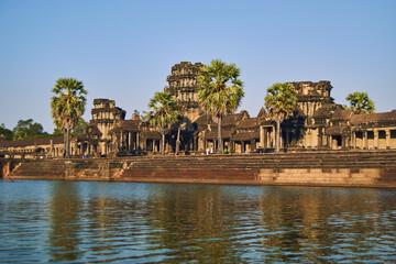 A huge temple, trees and a lake at Angkor Wat, Cambodia Wall mural