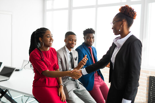 team of young african people in office with handshake