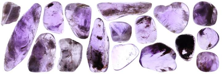 Isolated rutilated amethyst gemstones set texture.