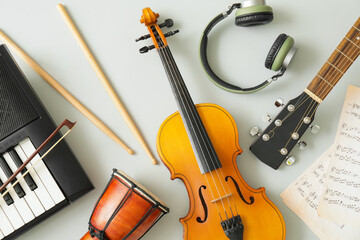 Obraz Different musical instruments and music notes on light background - fototapety do salonu