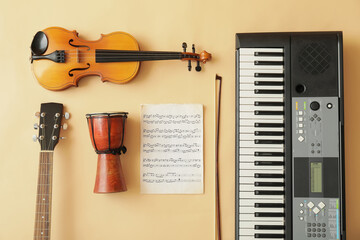 Different musical instruments and music notes on color background