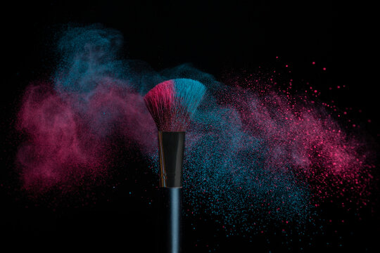 Blue and pink makeup on powder brush hit in a mixed cloud