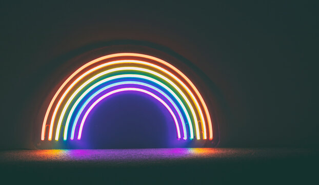 The led neon rainbow shines in the dark room