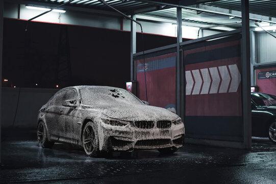 Kyiv, Ukraine - November 2019. BMW M3 F80 at the night car wash station.