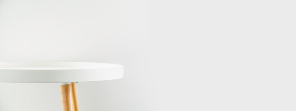 Banner empty modern round white table top at white house wall,Mockup space background for display or montage of product for advertising online