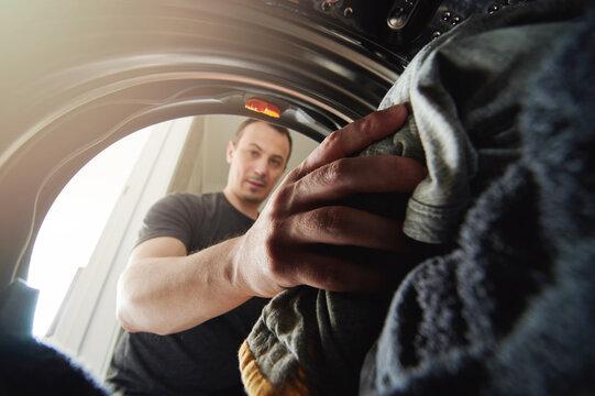 Young man doing housework