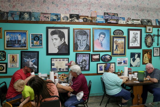 Patrons eat dinner at Pap's Place catfish restaurant, which closed for a time during the coronavirus disease pandemic lockdown, in Ackerman, Mississippi