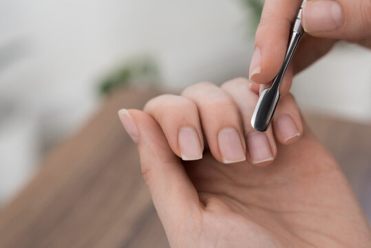 women hands making manicure itself at home