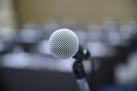 Microphone over the blurred business people forum Meeting Conference Training Learning Coaching Concept, Blurred background.