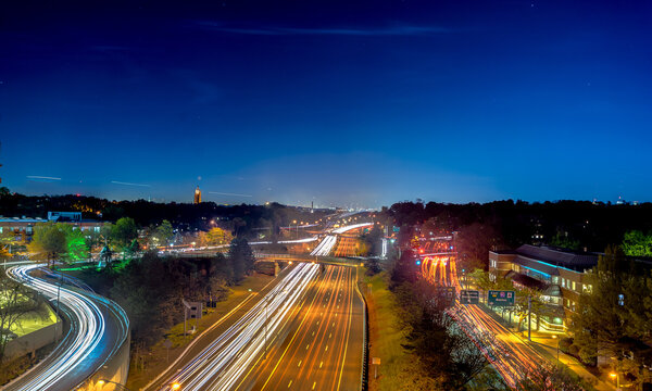 Long exposure of traffic along Storrow Drive at night in Beacon Hill Boston Massachusetts.