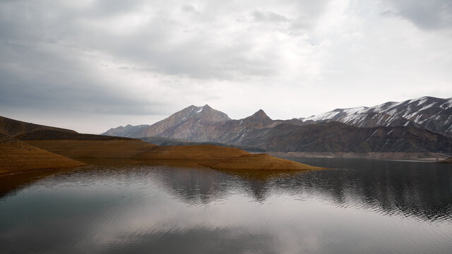 Scenic view of the Azat reservoir in Armenia with a snow-capped mountain range in the background