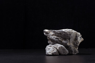 Luxury natural stone podium for showing packaging and product on black background, copy space. - fototapety na wymiar