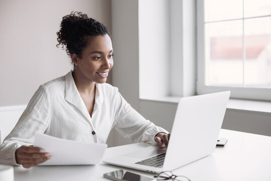 Young woman using laptop computer at office. Student girl working at home. Work or study from home, freelance, business, lifestyle concept