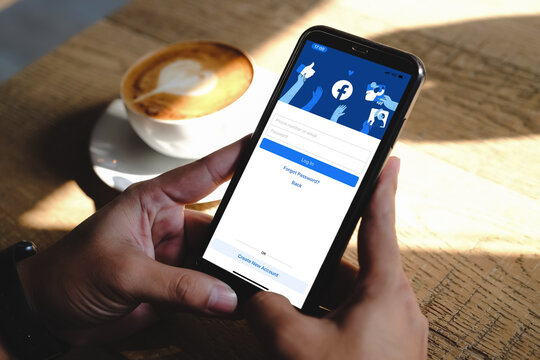 Bangkok. Thailand.JUNE 15,2020: Facebook social media app logo on log-in, sign-up registration page on mobile app screen on iPhone smart devices in business person's hand at work.