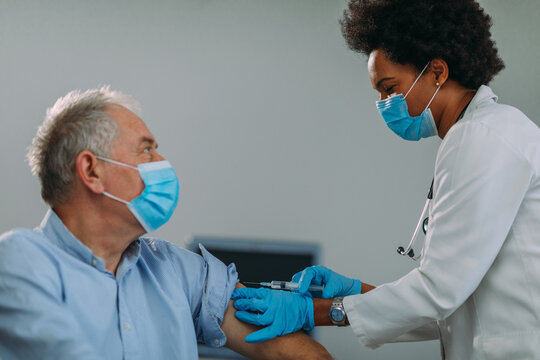 Senior man getting vaccinated at hospital