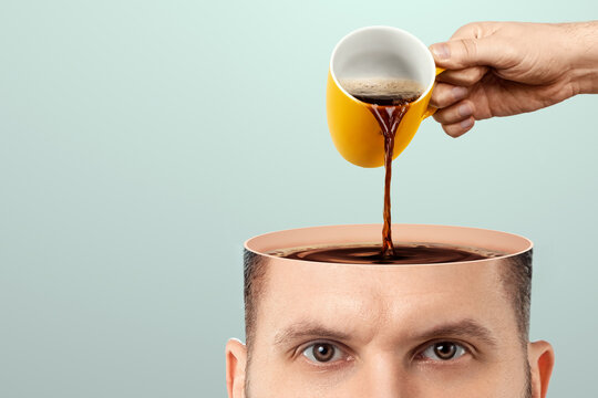 The man's head is open and coffee is poured into it from a cup. Creative background, coffee lover, brain drug, caffeine.