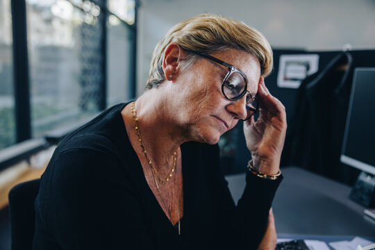 Businesswoman having stress on her job