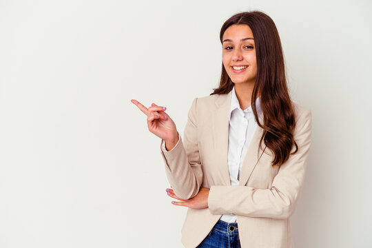 Young Indian business woman isolated on white background smiling cheerfully pointing with forefinger away.