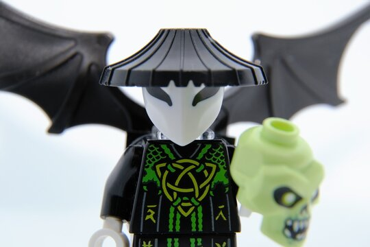 Lego Ninjago minifigures. Vangelis (also known as the Skull Sorcerer) with his skull. Closeup, selective focus. Warsaw, Poland - March 3 2021