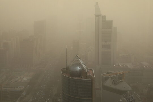 Beijing shrouded in smog after a sandstorm