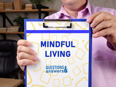 Business concept meaning MINDFUL LIVING with sign on the piece of paper.