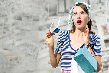 Amazed young sexy woman in glasses with shopping bags. Pop Art wow girl