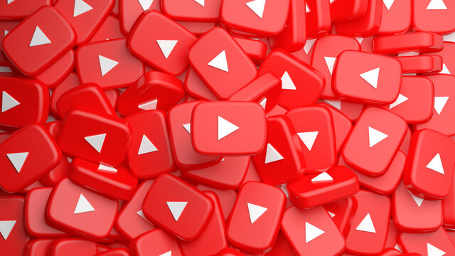 Valencia, Spain - March, 2021: Heap of YouTube play buttons in 3D rendering background. You tube video icon, logo symbol red banner, social media sign, mobile app, web video mark