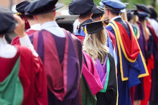 University graduates at graduation  ceremony, education concept