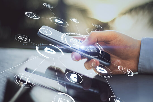Personal data information security with modern cell phone in man hand and virtual screen with digital security icons and fingerprint
