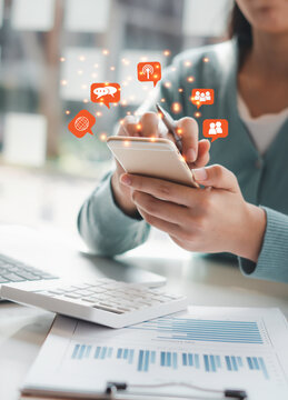 Young woman's hand is using a smartphone to play social media, a mobile phone with a notification icon,Social Distancing ,Working From Home concept.