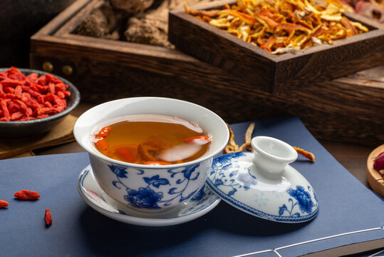 Traditional Chinese health tea and classical medical books on the table