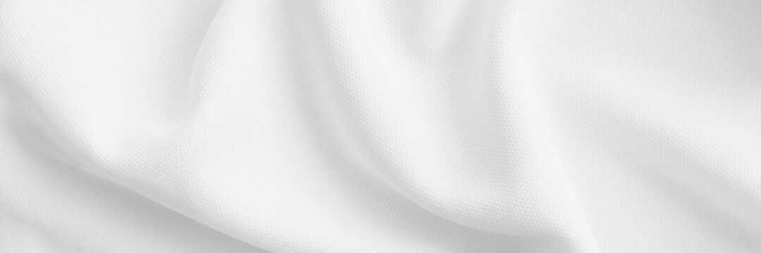 White wavy clothes background. fabric texture