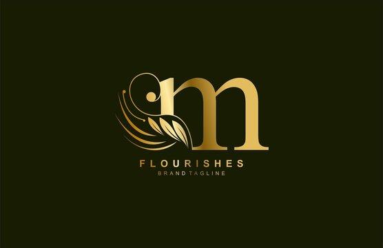 lowercase letter m linked beauty flourish golden color logo design