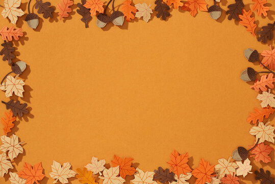 Autumn background, tree paper leaves, yellow backdrop,