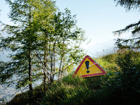 A yellow warning sign in the mountain