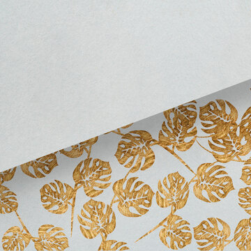 Painted golden leafs with copy space