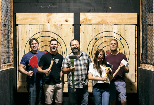 Group Of Friends Pose For Photo After Throwing Axes