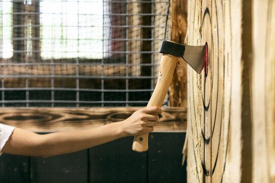 Woman Removes Hatchet from Bullseye Target