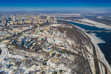Wall Murals Kiev Beautiful winter top view of the Kiev-Pechersk Lavra. Many churches in the snow. Beautiful panorama of Kiev in the afternoon.