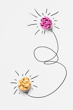 Sketch of lighting two bulbs from paper balls.